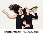 two beautiful women in black... | Shutterstock . vector #438027508