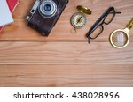 woodtable with camera and... | Shutterstock . vector #438028996