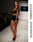 miami  fl   july 16  a model... | Shutterstock . vector #438039370