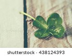 Stock photo green clover leaf on wooden background close up 438124393