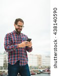 young bearded man texting on... | Shutterstock . vector #438140590