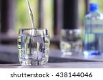 closeup glass of water on table ... | Shutterstock . vector #438144046