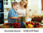 mother and child preparing... | Shutterstock . vector #438149560