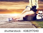 trip and woman legs  | Shutterstock . vector #438297040