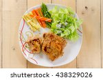 grilled steaks on white dish... | Shutterstock . vector #438329026
