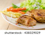 grilled steaks on white dish... | Shutterstock . vector #438329029
