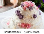 white wedding cake with roses | Shutterstock . vector #438434026