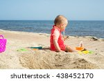 baby alone at the seaside | Shutterstock . vector #438452170