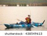 Fisherman Fishing On Kayak On...