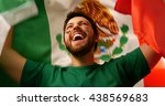 mexican fan celebrates holding... | Shutterstock . vector #438569683
