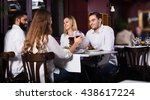 group of smiling friends having ... | Shutterstock . vector #438617224