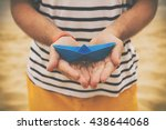 Guy Holding Paper Boat Outdoor...