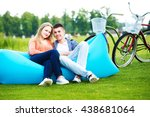 young couple seated on a couch... | Shutterstock . vector #438681064