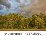 storm clouds over trees that... | Shutterstock . vector #438715090