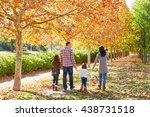 family walking in an autumn... | Shutterstock . vector #438731518