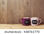 coffee cups on wooden table... | Shutterstock . vector #438761770
