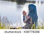 muslim woman reading holy quran | Shutterstock . vector #438778288