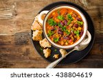 chili con carne on a wooden... | Shutterstock . vector #438804619