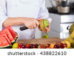 chef cutting a delicious kiwi... | Shutterstock . vector #438822610