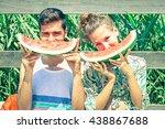 positive couple eating... | Shutterstock . vector #438867688