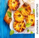 grilled pineapple slices with... | Shutterstock . vector #438975760