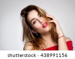 seductive young woman with red... | Shutterstock . vector #438991156