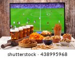 Beer And Snacks Set On Footbal...
