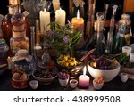 Small photo of Mystic still life with dry herbs, old bottles, candles and flasks. Old pharmacy, esoteric or alchemic concept. Black magic and occult objects, alternative medicine or homeopathic still life