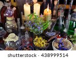 Small photo of Alternative medicine still life with bottles, flasks, candles, dry berries and herbs. Old pharmacy, esoteric or alchemic concept. Black magic and occult objects, medieval homeopathic still life