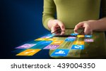 hand holding tablet device with ... | Shutterstock . vector #439004350