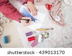 fashion designer drawing in her ... | Shutterstock . vector #439013170