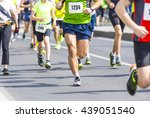 marathon runners with their... | Shutterstock . vector #439051540