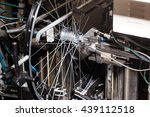 Small photo of Bicycle service. Mechanical Spokes attachment to wheel for precision alignment. Wheel Assembling Machine is used to align.