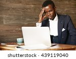stressed and worried african... | Shutterstock . vector #439119040