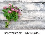 Clover Flowers On Wooden...