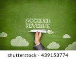 Small photo of Accrued revenue concept on blackboard with paper plane