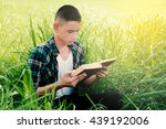 young man holding book in the...   Shutterstock . vector #439192006