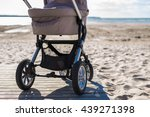 Baby Stroller On Beach At Sunn...