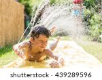 boy cooling down with garden... | Shutterstock . vector #439289596