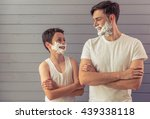 handsome young father and his...   Shutterstock . vector #439338118