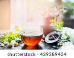Cup Of Hot Herbal Tea On Windo...