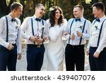bride posing with bridesmen in... | Shutterstock . vector #439407076
