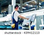 worker entering data in cnc...   Shutterstock . vector #439412113