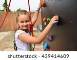 Happy Girl Climbing Wall