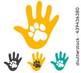 hand and pet dog paw. | Shutterstock .eps vector #439436380