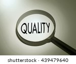 Small photo of Magnifying glass with the word quality. Searching quality