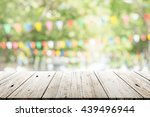 empty wooden table with blurred ... | Shutterstock . vector #439496944