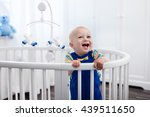 cute laughing baby standing in... | Shutterstock . vector #439511650