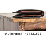 Brown Leather Wallet On Wooden...