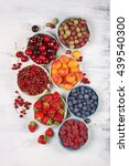 various fresh fruits in bowls... | Shutterstock . vector #439540300